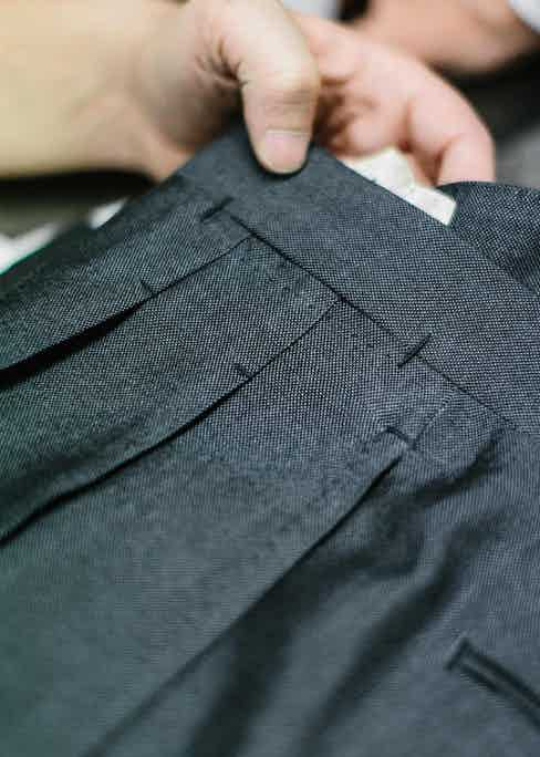 A close-up of Neapolitan trouser specialist Marco Cerrato's reverse pleated trousers, which showcase the handiwork that goes into each pair, such as immaculate top stitches, bar tacks and pressing. Photo by Jamie Ferguson.