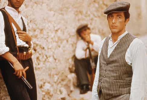 Michael Corleone's waistcoat and trousers are cut in slightly different striped cloths, but complement each other in tonal greys. The waistcoat features jetted ticket pockets and is worn over a collarless shirt in The Godfather, set in 1945.