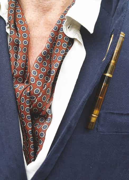 Also at the ready, in the buttonhole of William's lapel is his Pelikan pen, which he likes because it's semi-transparent and doesn't leak on airplanes.