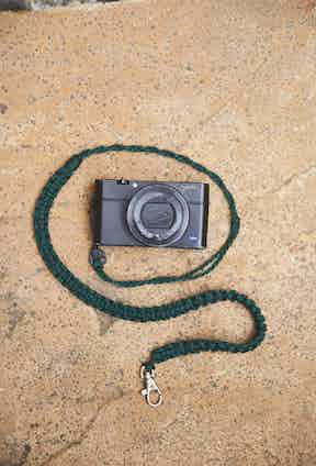 He always carries his Sony RX1003, and he keeps hold of it using this perfectly measured lanyard, so if he drops it, it won't come to an early death courtesy of the pavement.