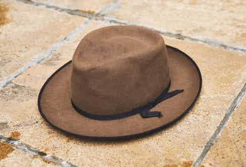 William wears a fedora by the age-old American hatmakers Stetson, a name that has become synonymous with quality millinery. It was a gift from a musician whose identity he'd rather not reveal.