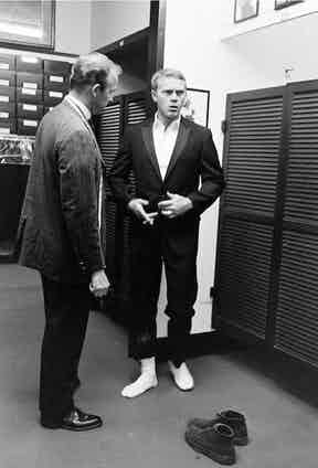 Steve McQueen was rarely seen without his chukka boots, which were sufficiently smart to wear to one's tailor in California, 1963.