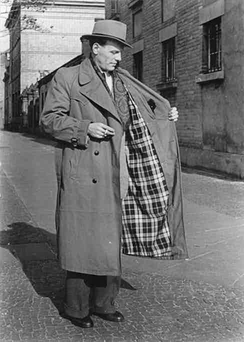 Burberry's first trench coat designed for civilians was crafted from waterproof gabardine and boasted wide peaked lapels, a belted waist and a checked cotton lining.