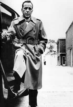 Humphrey Bogart immortalised the trench coat in Casablanca and The Maltese Falcon but he was also a loyal customer to Aquascutum, pictured here in a double-breasted belted trench, circa 1958.