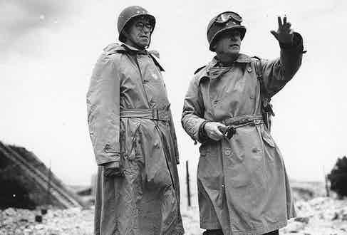 Lieutenant General Omar Bradley (left) and Major General J. Lawton Collins wear military trench coats crafted from waterproof gabardine. Pictured here in Cherbourg, France 1944.