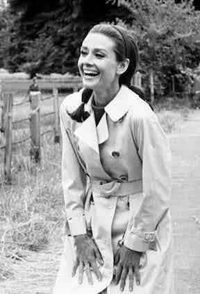 Audrey Hepburn proved the trench's unisex appeal, pictured here in a classically-styled version with a belted waist during the filming of Two for the Road, 1966.