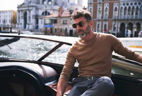 Camel wool jumper, Moncler; slate grey wool trousers, AMI; amber tortoise and tobacco lenses sunglasses, The Bespoke Dudes at The Rake. Sea green leather belt, property of The Rake.