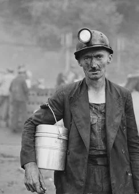 A coal miner from the Inland Steel Company wears a double-breasted unstructured jacket and denim dungarees, Kentucky, USA, 1946.