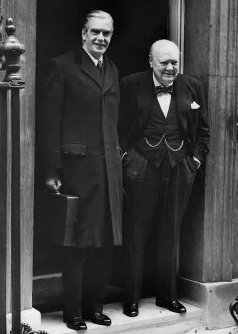 Churchill with Sir Anthony Eden on the steps of 10 Downing Street, London, 1955. He wears his Breguet pocket watch on a chain that looks suspiciously like a 'W'.