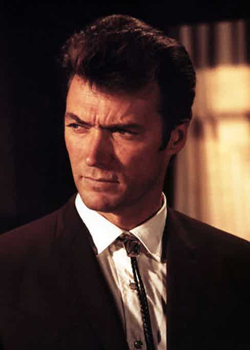 Clint Eastwood as Walt Coogan in Coogan's Bluff, sporting a plaited black and silver bolo tie.