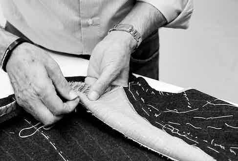 Luigi Dalcuore hand-stitching in his Naples workroom.