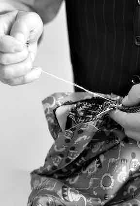 Luigi Dalcuore stitching in his workshop.