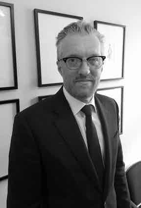 Roger Stephenson, Lock & Co.'s Deputy Chairman, holds the hatmaker's royal warrants.