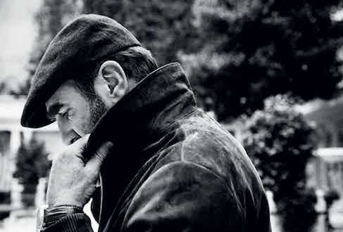 Eric Cantona wears a tweed flat cap by Lock & Co. in issue 46 of The Rake. Photograph by Simon Emmett.