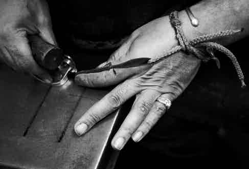 One of Lock & Co.'s artisans hand-crafting a hat.