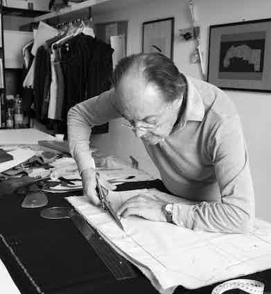 Luigi Dalcuore cutting a jacket pattern.