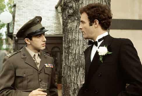 Captain Corleone attending his sister's wedding in full military dress regalia.