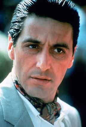 Al Pacino as Don Michael Corleone in The Godfather: Part II, wearing a geometric printed cravat, 1974.
