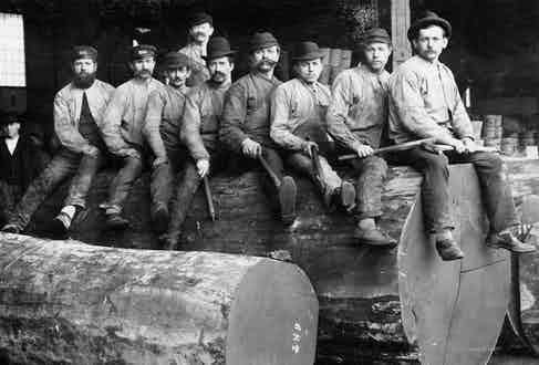 Gold miners wearing denim jeans and cotton over-shirts, circa 1900s.