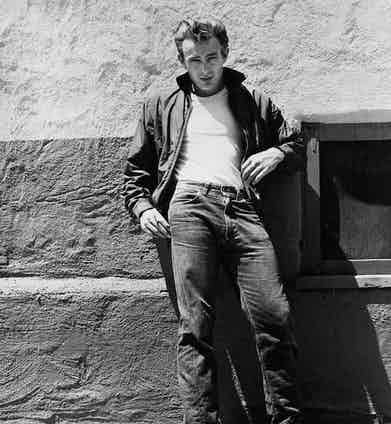 Two years later came James Dean in Rebel Without a Cause. Here, his denim jeans are paired with a white T-shirt and a Harrington jacket.