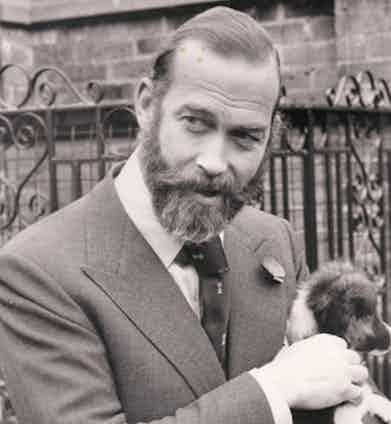 Prince Michael of Kent demonstrates how a large Windsor knot stands up well to sizeable peak lapels. Note also the addition of a poppy in the lapel buttonhole.