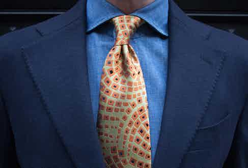 When tying a four-in-hand, the tie knot should always have a dimple or two. This Charvet necktie has been produced from vintage fabric exclusively for The Rake.