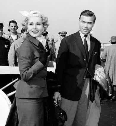 Porfirio Rubirosa with Zsa Zsa Gábor on the tarmac, circa 1954.
