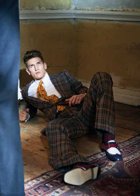 Checked wool suit, Nutters of Savile Row circa 1974 from the Edward Sexton archive; white cotton shirt and yellow-gold collar pin, both Edward Sexton; Rubiroso shoes, Manolo Blahnik; Classique timepiece, Breguet; signet rings, Rebus. Photograph by Jake Walters, styling by Tom Stubbs.