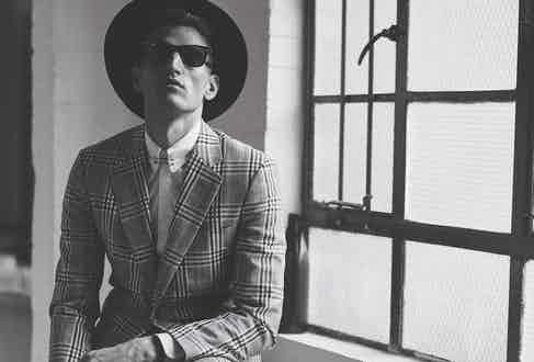 Mohair oversized Prince of Wales checked suit, Dunhill; white shirt, DSquared2; sunglasses, Ray-Ban; Chelsea creeper boots, Underground; black lisle socks, London Sock Company. Photograph by Simon Lipman, styling by Sarah-Ann Murray.