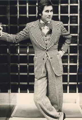Tailor Tommy Nutter clashes a houndstooth and Prince of Wales check in his tailoring, circa 1960s.