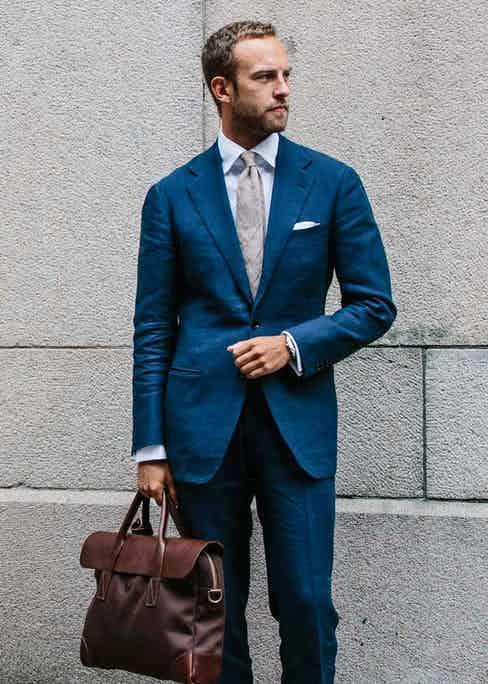 Andreas Weinas fuses classic with modern - while the suit and briefcase is formal, the fabric of both is modern and softens the look. Photo by Jamie Ferguson.
