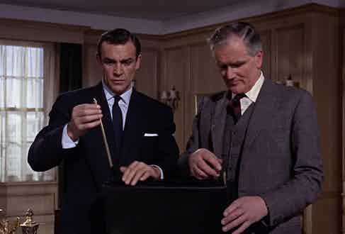 James Bond examines the deadly contents in his briefcase in 1963's From Russia with Love.