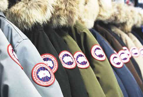 A line-up of coats bearing the red, white and blue logo.
