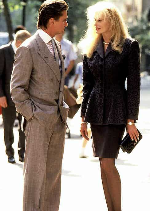 Gekko's grey double-breasted suit is noticeably padded in the shoulders to form a masculine silhouette. His jacket is nonchalantly only buttoned on one row, and his wide-legged trousers illustrate generous drape on his slim figure. Photograph by 20th Century Fox Film Corp./courtesy Everett Collection/Alamy.