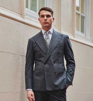 """Dalcuore's flannel double-breasted suit is """"cosy, comforting and cuts a dash in grey"""". Photo by James Munro."""