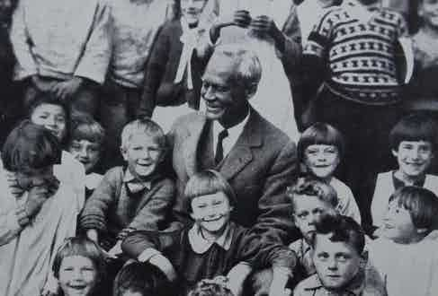 Sir Wilfred Grenfell with orphans from the St Anthony Orphanage. The majority lost their fathers at sea during fishing expeditions, circa 1938.