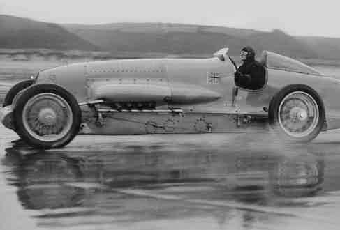 Sir Malcolm Campbell testing the 450 Hp Motor Car in one of his driving suits made from Grenfell Cloth.