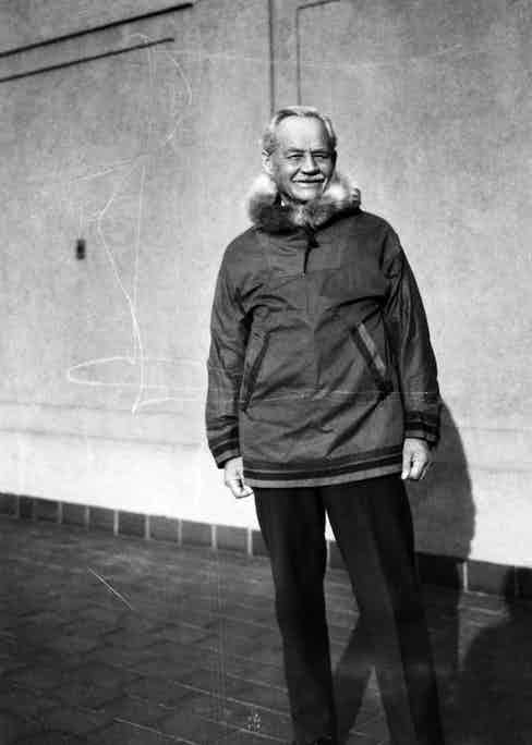 Sir Wilfred Grenfell wearing a kagoule-like jacket in Grenfell Cloth with a fur-trimmed hood, circa 1938.