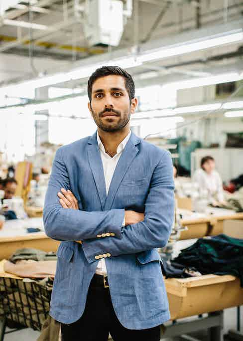 Mo Azam, Managing Director of Grenfell, on the factory floor in east London. Photo by Jamie Ferguson.
