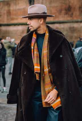 Jonathan Edwards wears a Lock & Co. Hatters fedora to brave low temperatures in Florence. Photo by Jamie Ferguson.