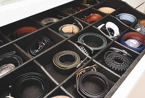 Leather belts in black, brown, blue and tan are embellished with studs, buckles, colourful linings and contrast stitching.