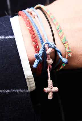 It's the personal touches that tell you the most about why someone dresses in a certain way. Some people spend vast amounts of money on expensive bracelets, but George keeps things personal and touching, as these were all made by family and friends over the years.