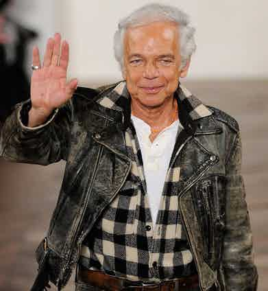 Ralph Lauren closes his AW08 fashion show in New York wearing a distressed leather motorcycle jacket paired with a plaid shirt and denim jeans.