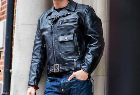 Aero Leather's black Daytona leather jacket features a buckle waist, a zip closure and is lined with cotton drill for a comfortable wear. Photograph by James Munro.