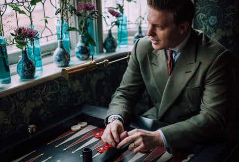 """Another rule Tom lives by: """"Try and match your socks with your tie, or match something. I like that the red in this Sera Fine silk tie picks out the red in the jacket's overcheck and my socks."""""""