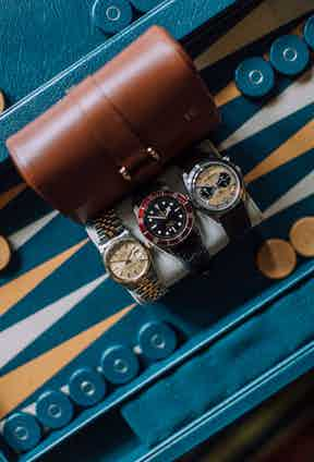 """""""The Tudor Black Bay was a treat to myself when I started at The Rake. I received the Rolex from my father when I turned 30, and that's earmarked for my son Harry. I've fallen more and more in love with Bell & Ross over the years, and love the [BR V2-94] Bellytanker."""" Named after the tank on the belly of planes which were repurposed for motor racing in the 1950s, the peachy colour feels undeniably vintage. """"Annoyingly, my wife looks rather good in all of them, so I have to share,"""" Tom jokes."""