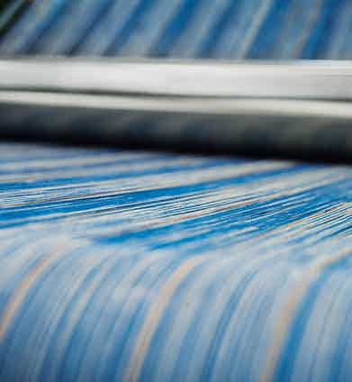 Yarns on the warping beam. Photograph by Luke Carby.