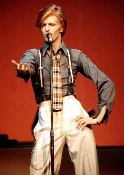 David Bowie wears braces on stage, circa 1974.
