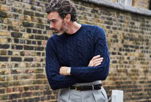 Richard Biedul wears Edward Sexton's cable knit jumper in navy, which is chunky enough to retain warmth and fine enough to tuck into a pair of Hollywood top trousers. Photograph by James Munro.