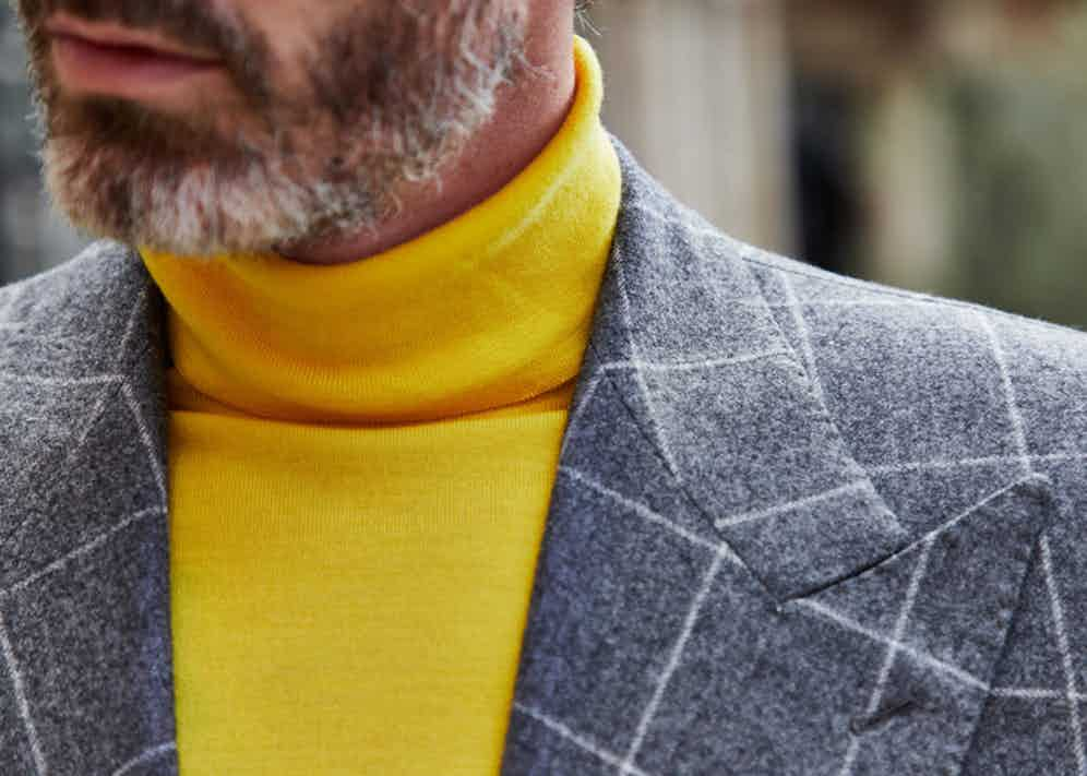 Richard Biedul wears a fine-knit Edward Sexton merino wool roll neck in canary yellow under a grey wool windowpane check tailored jacket. Photograph by James Munro.